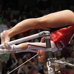 Oklahoma's McKenzie Wofford competes on the uneven bars during the NCAA college women's gymnastics championships on Saturday, April 19, 2014, in Birmingham, Ala. (AP Photo/Butch Dill)