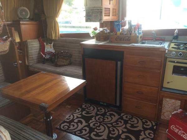 Kitchen with mini fridge and stove