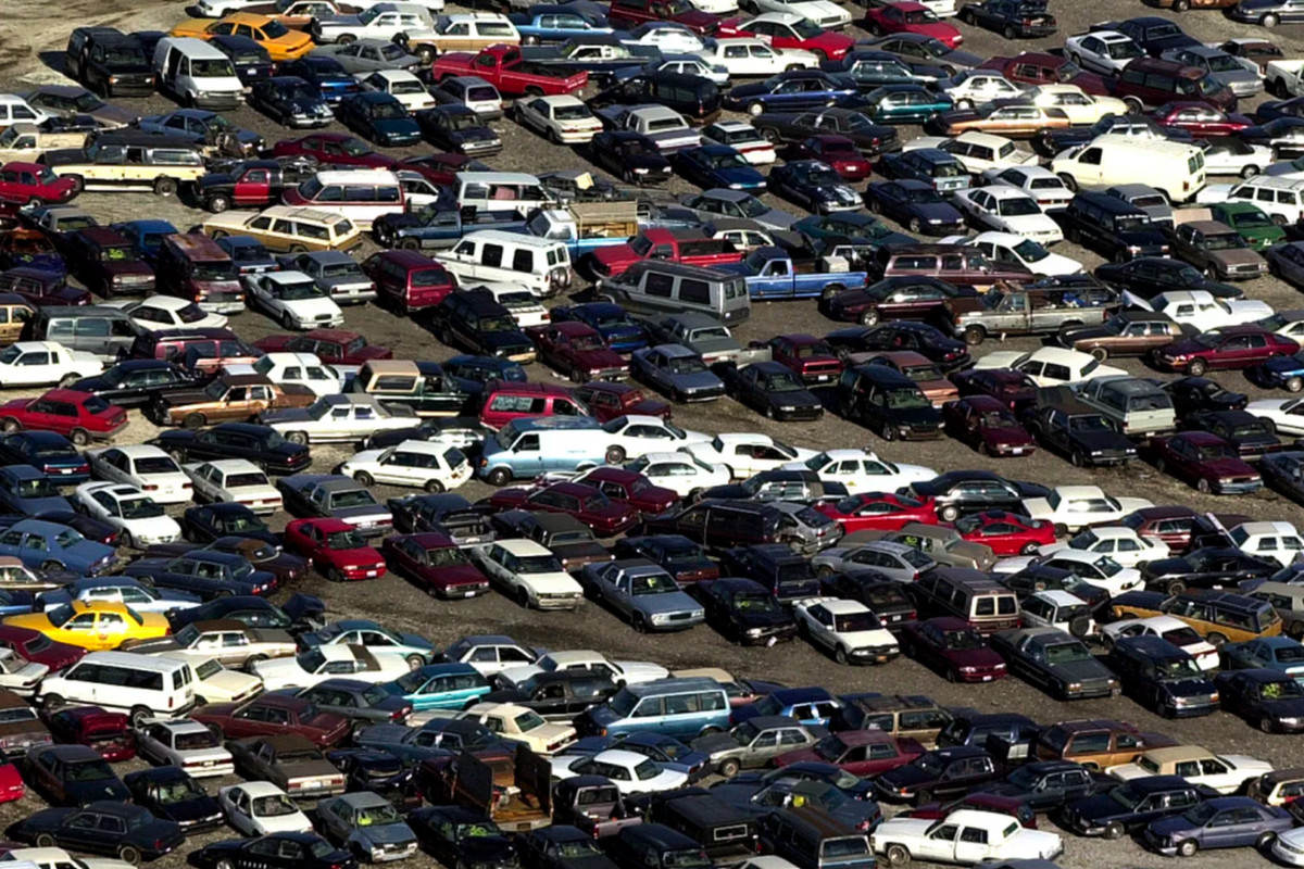 Hundreds of towed vehicles are parked at an auto pound owned by the city of Chicago.