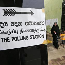 A Sri Lankan Muslim woman leaves a polling station after casting her vote in Kattankudi, Sri Lanka, Saturday, Sept. 8, 2012. Sri Lankans voted in a provincial assembly election seen as a test of whether minority ethnic Tamils still want self-rule or are content with the government's development of an area devastated by a quarter-century civil war.