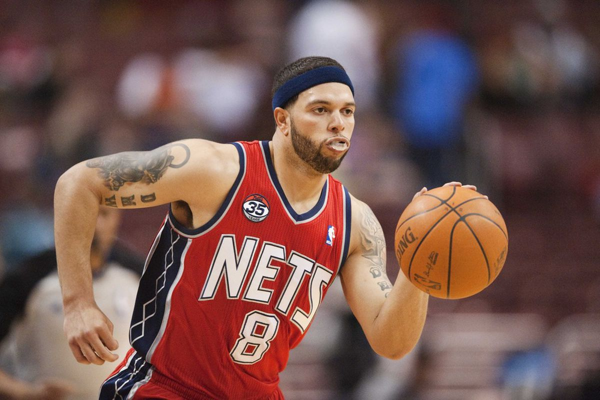 New Jersey Nets guard Deron Williams (8) brings the ball up court during the second quarter against the Philadelphia 76ers at the Wells Fargo Center. Howard Smith-US PRESSWIRE