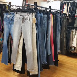 Against the walls behind the denim are racks featuring even deeper discounts.