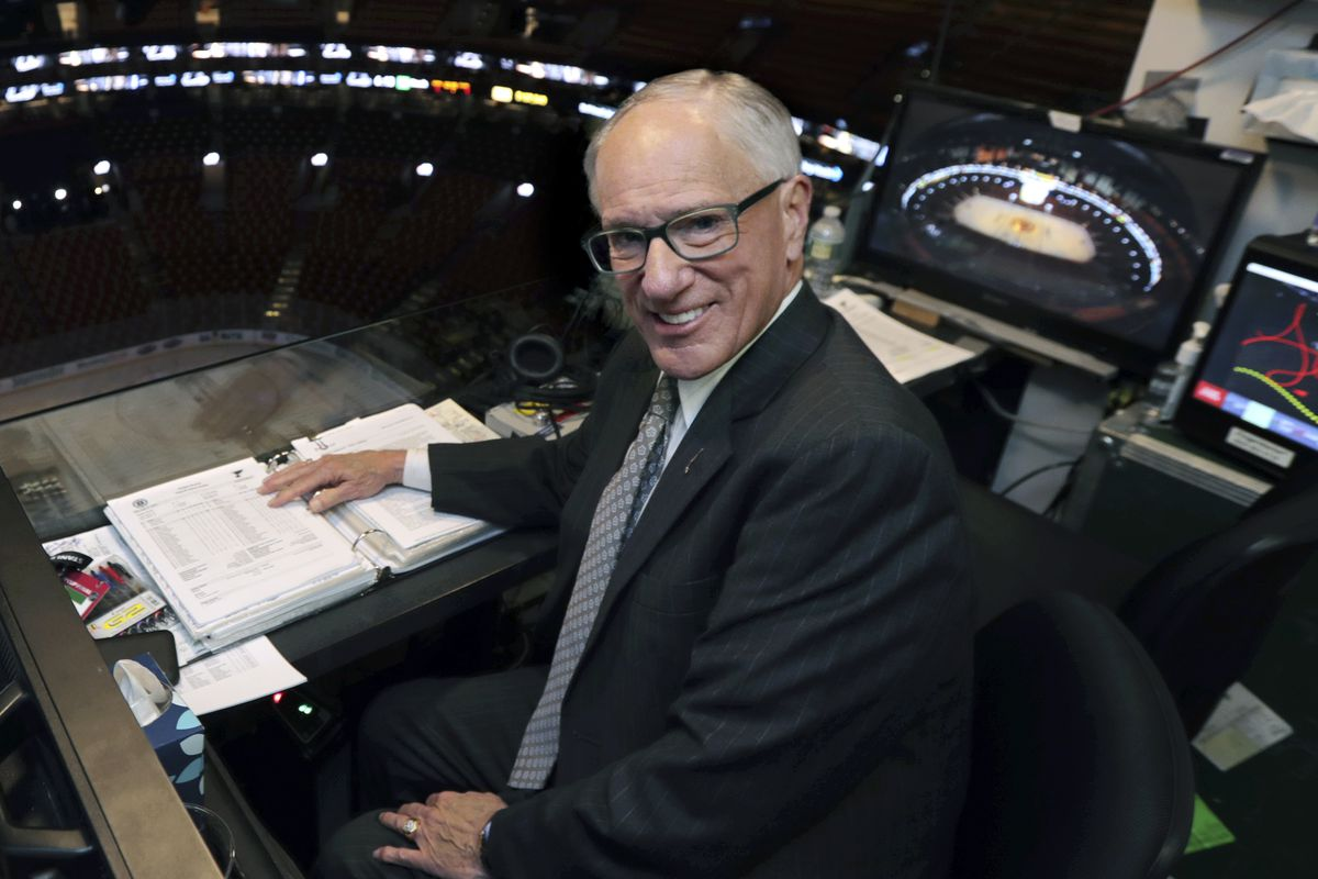NBC hockey broadcaster Mike Emrick poses for a photo while preparing to call Game 2 of the NHL hockey Stanley Cup Final between the St. Louis Blues and the Boston Bruins in Boston in 2019.