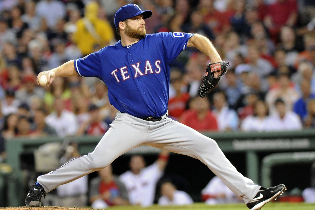 August 7, 2012; Boston, MA, USA; Texas Rangers starting pitcher Ryan Dempster (46) pitches during the fourth inning against the Boston Red Sox at Fenway Park. Mandatory Credit: Bob DeChiara-US PRESSWIRE