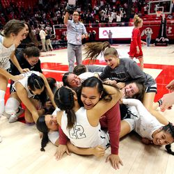 Highland players celebrate their championship as the Rams defeat Springville in the 5A State Basketball Championship in the Huntsman Center at the University of Utah in Salt Lake City on Saturday, Feb. 29, 2020. Highland won 46-34.