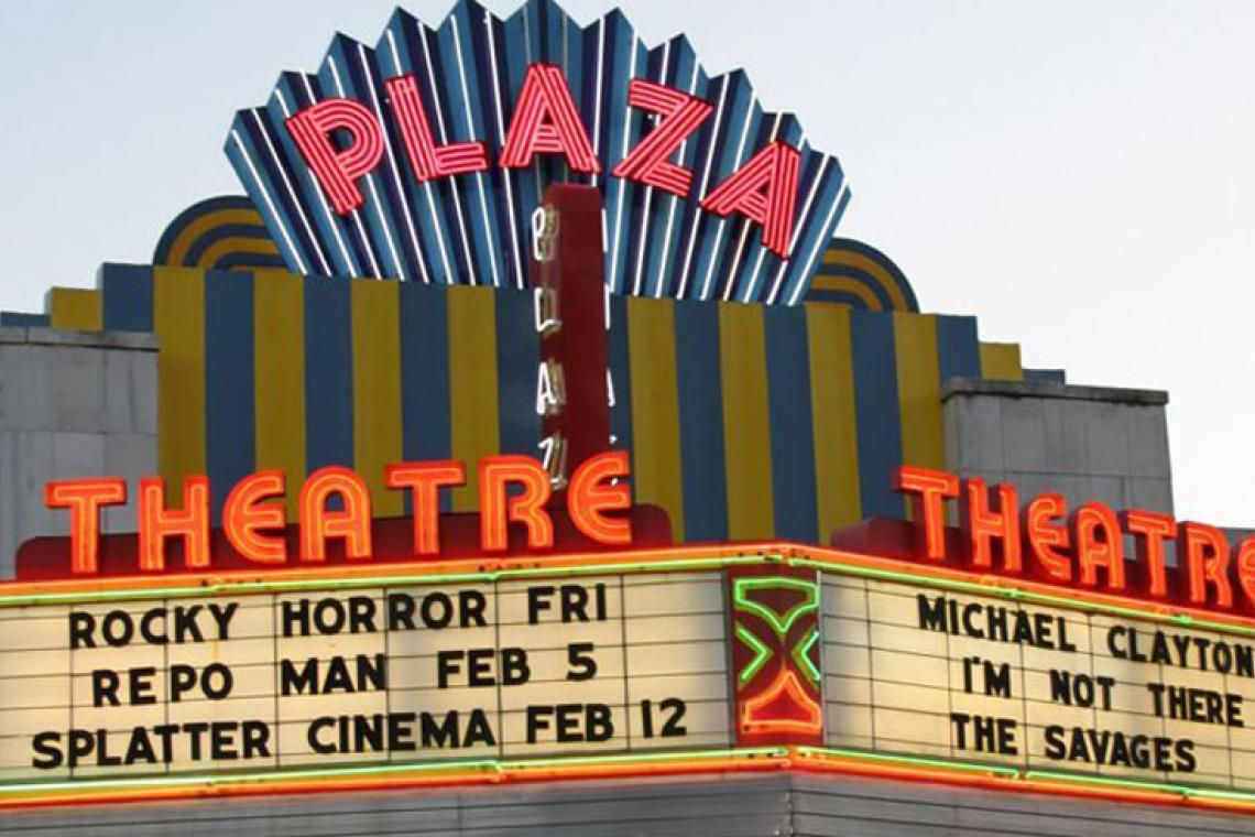 Lighted marquee with Plaza Theatre in neon.