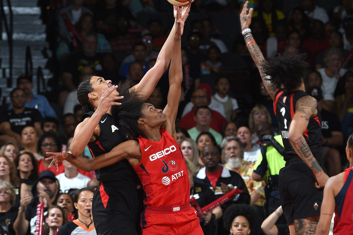 Liz Cambage of the Las Vegas Aces and LaToya Sanders of the Washington Mystics go for a rebound during Game Four of the 2019 WNBA Semifinals on September 24, 2019 at the Mandalay Bay Events Center in Las Vegas, Nevada.