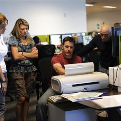Engineers Christy Carson, Colleen More, Josh Mechan and Mark Porreca work in the product development area at the Provo Craft corporate offices in South Jordan Friday, July 16, 2010.