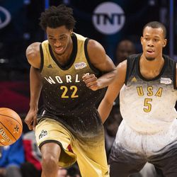 World forward Andrew Wiggins (22) chases the ball in front of United States' Rodney Hood (5) of the Jazz during the second half of the NBA Rising Stars Challenge basketball game in Toronto on Friday, Feb. 12, 2016.