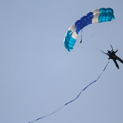 A Parachuter bring the game ball in to the stadium