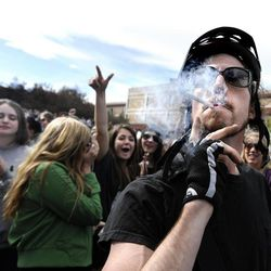 An unidentified man smokes a marijuana cigarette outside of the Duane Physics building during the 4/20 rally on the University of Colorado campus in Boulder, Colo., on Friday, April 20, 2012. Many students at the University of Colorado and other campuses across the country have long observed 4/20. The counterculture observation is shared by marijuana users from San Francisco's Golden Gate Park to New York's Greenwich Village.