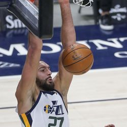 Utah Jazz center Rudy Gobert (27) dunks the ball during a preseason NBA game against the Phoenix Suns at the Vivint Smart Home Arena in Salt Lake City on Monday, Dec. 14, 2020. The Jazz beat the Suns 111-92.