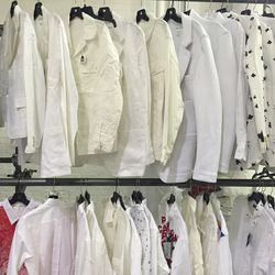There are a lot of white shirts for men...