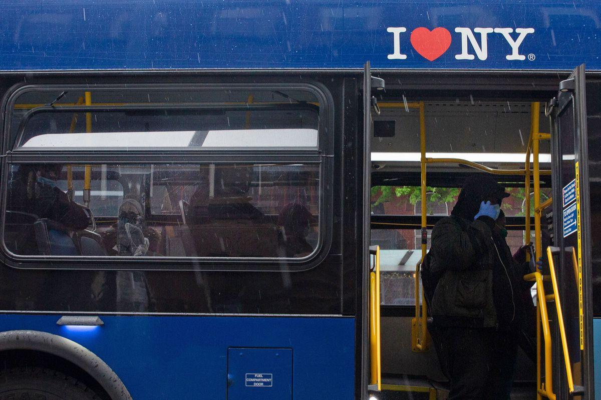 People ride an MTA bus through Brooklyn during the coronavirus outbreak.