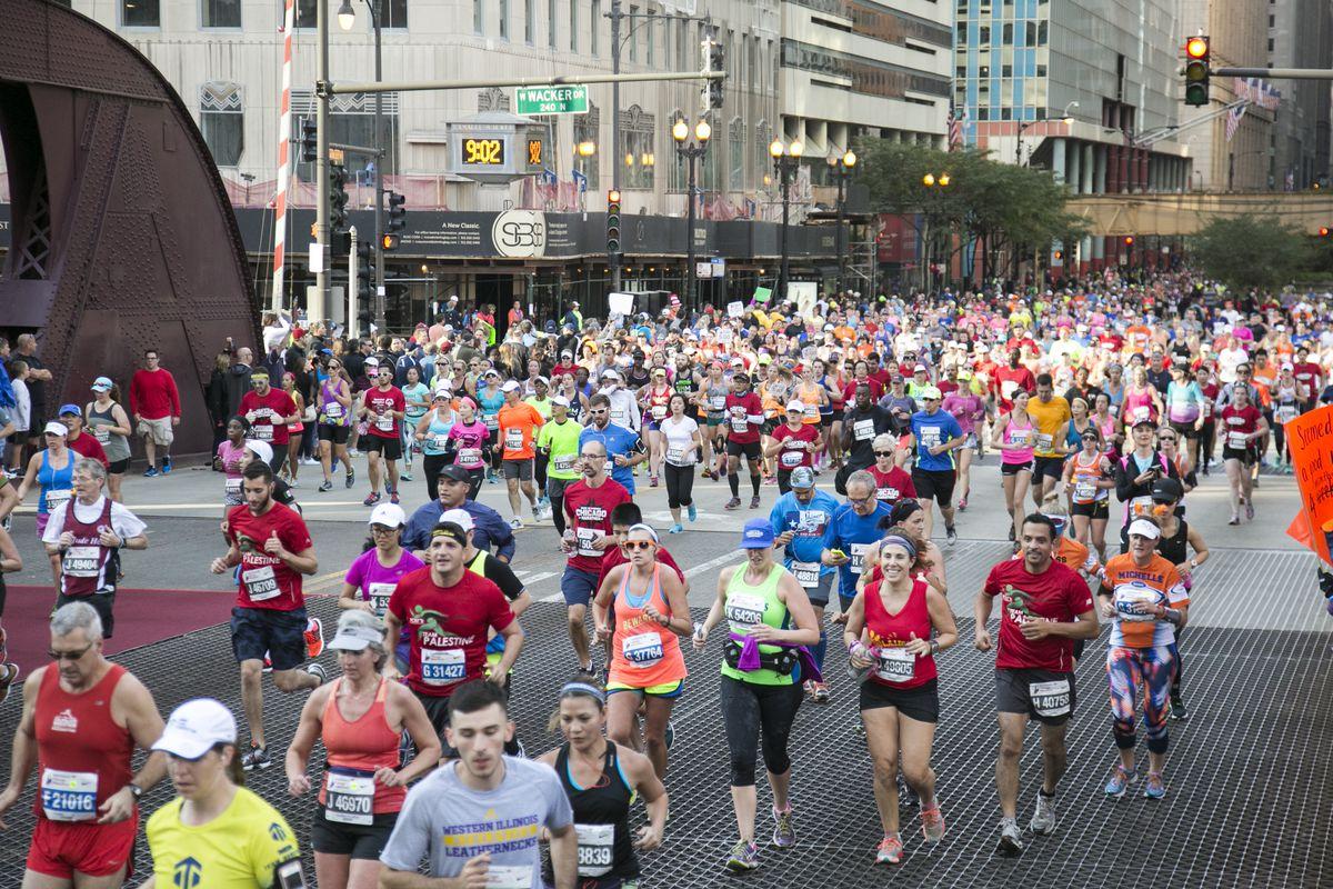 Runners race down LaSalle Street near Wacker Drive during the 2015 Bank of America Chicago Marathon on Sunday, Oct. 11, 2015.