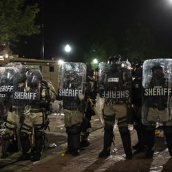 Police use tear gas on protesters as they clash outside the Kenosha County Courthouse in the second night of unrest after police shot Jacob Blake, Monday night, Aug. 24, 2020.