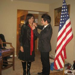 David Archuleta gives his mother, Lupita, an Eagle pin in December 2010. The celebrity singer received his Eagle Scout Award two years after he completed his merit badges and service project.