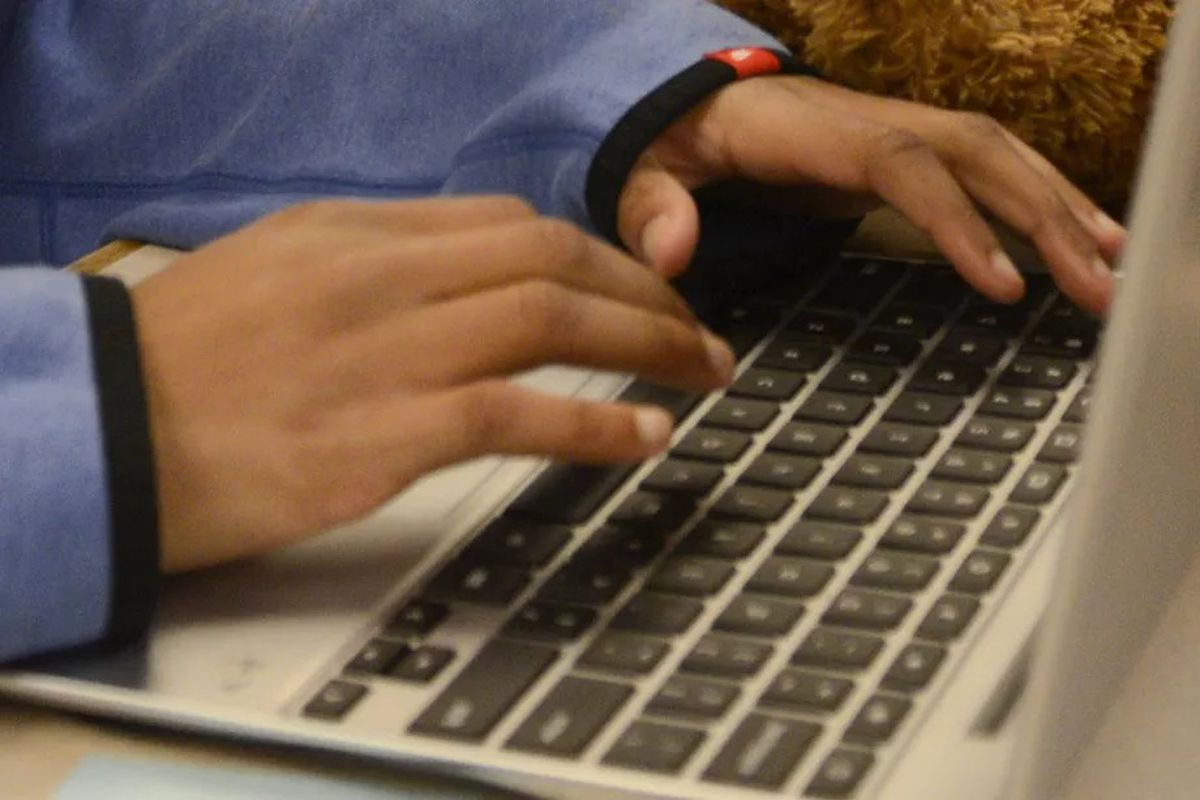 A Chicago Public Schools student types on a computer keyboard.