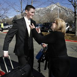 Elder Taylor Pickering hugs his mother Christina  and says goodbye as he arrives at the Provo Missionary Training Center of The Church of Jesus Christ of Latter-day Saints in Provo, Utah, Wednesday, Feb. 2, 2011.
