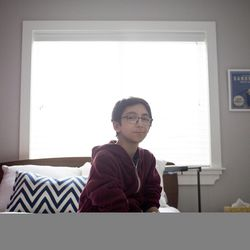 Noah Chesler, an eighth-grader at Wasatch Junior High School, is pictured in his home in Salt Lake City on Tuesday, Feb. 9, 2016. Noah underwent a bone marrow transplant in March 2010. After the surgery, Noah was immunocompromised for two years. Just when he was about to start school again in 2011, a measles outbreak hit Granite School District and he had to be pulled back.