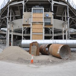 Just behind center field, where the main bleacher gate is located underneath the scoreboard