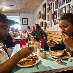 Zilton Lawson [left] and Jason Fairbanks eat breakfast at Home Grown.