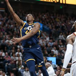 Utah Jazz guard Donovan Mitchell (45) lays it in during the game against the Cleveland Cavaliers at Vivint Arena in Salt Lake City on Saturday, Dec. 30, 2017.