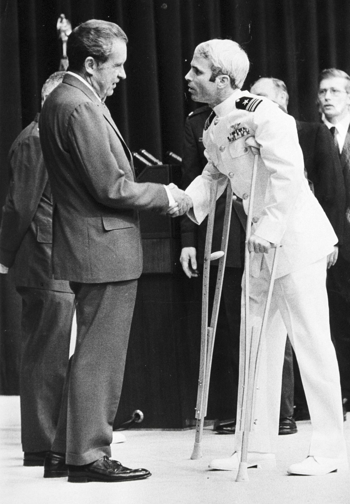 US Navy pilot John Mccain Is welcomed by President Richard Nixon upon Mccain's release from five-and-a-half years as a POW during the Vietnam War, on May 24, 1973, in Washington, DC.