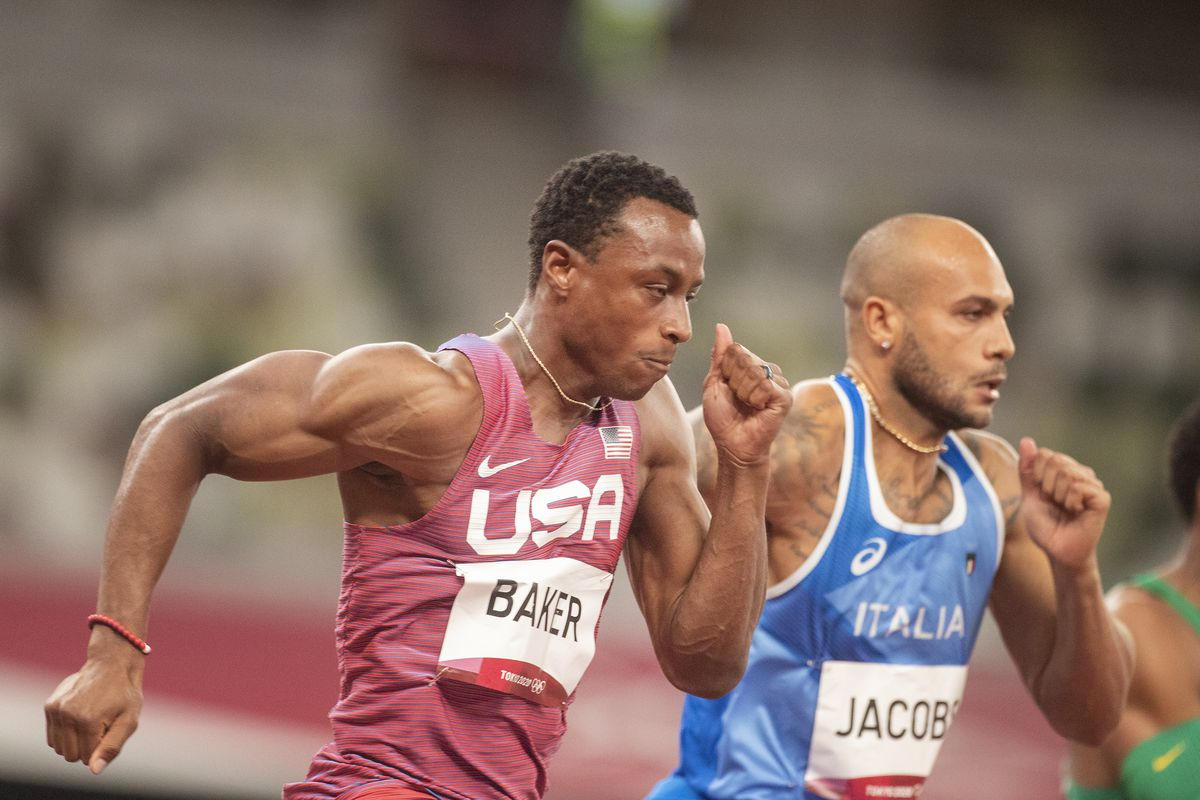 Ronnie Baker of the United States and Lamont Marcell Jacobs of Italy in action in the 100m semi final for men during the Track and Field competition at the Olympic Stadium at the Tokyo 2020 Summer Olympic Games on July 31, 2021 in Tokyo, Japan.