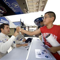 Racer Luis Diaz greets one of his fans at a race in Elkhart, Wis., August 2007.