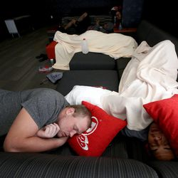 Hiva Lutui, left, and Karl Williams nap in the new Spence and Cleone Eccles Football Center at the University of Utah in Salt Lake City on Thursday, Aug. 15, 2013.
