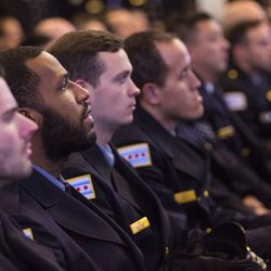 Officers watch the funeral for Officer Samuel Jimenez in an overflow room. | Ashlee Rezin/Sun-Times