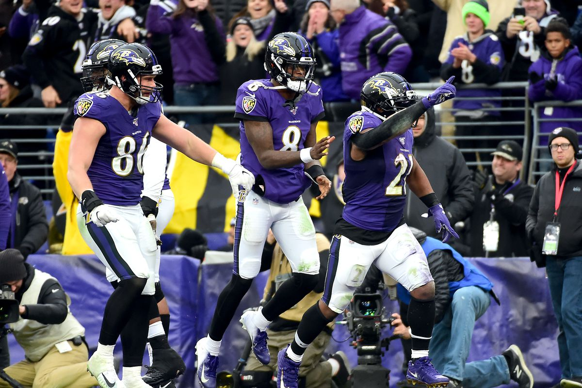 Baltimore Ravens running back Mark Ingram II celebrates with quarterback Lamar Jackson and tight end Nick Boyle after scoring a touchdown in the fourth quarter against the Houston Texans at M&T Bank Stadium.