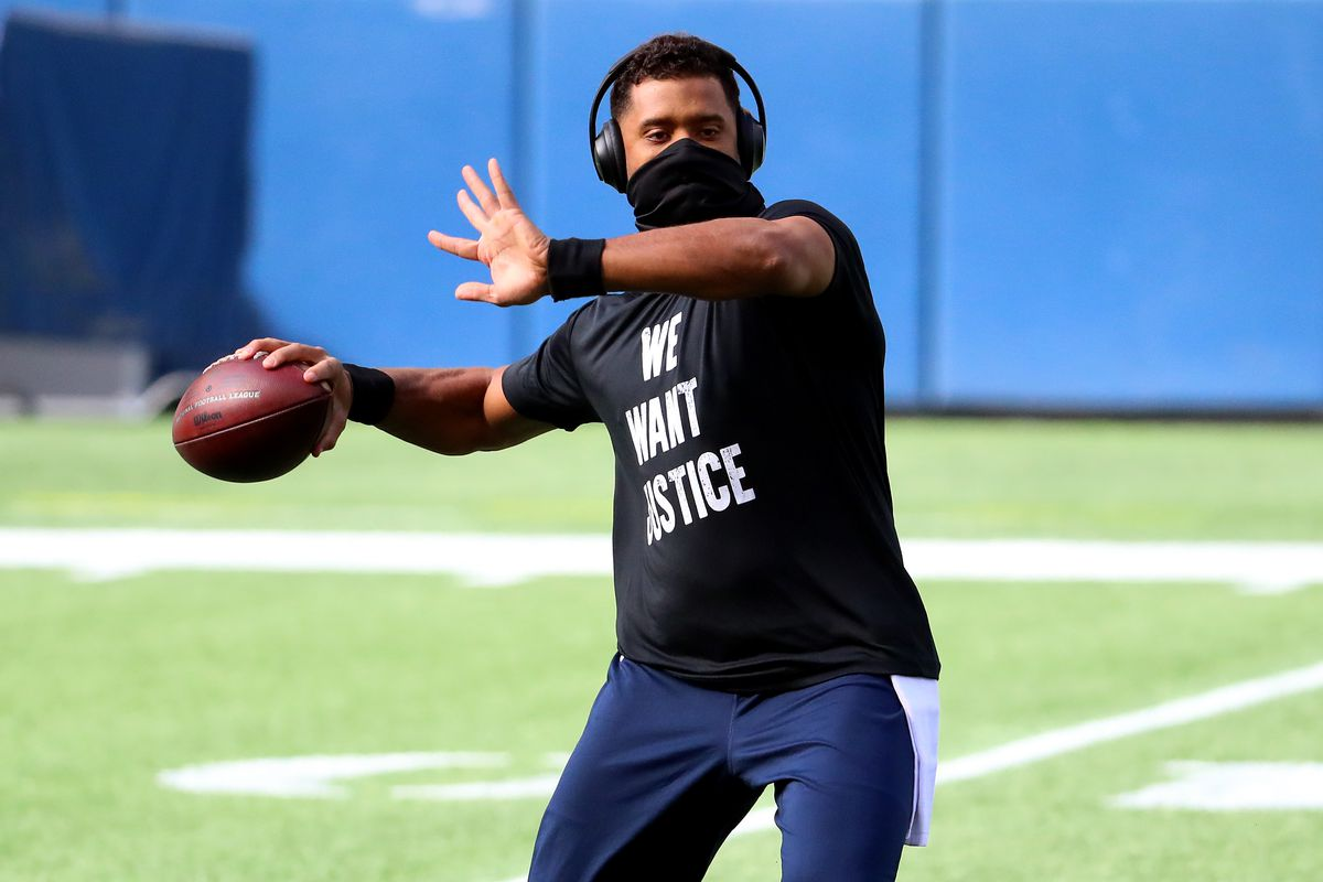 Russell Wilson #3 of the Seattle Seahawks warms up prior to the game against the Dallas Cowboys at CenturyLink Field on September 27, 2020 in Seattle, Washington.