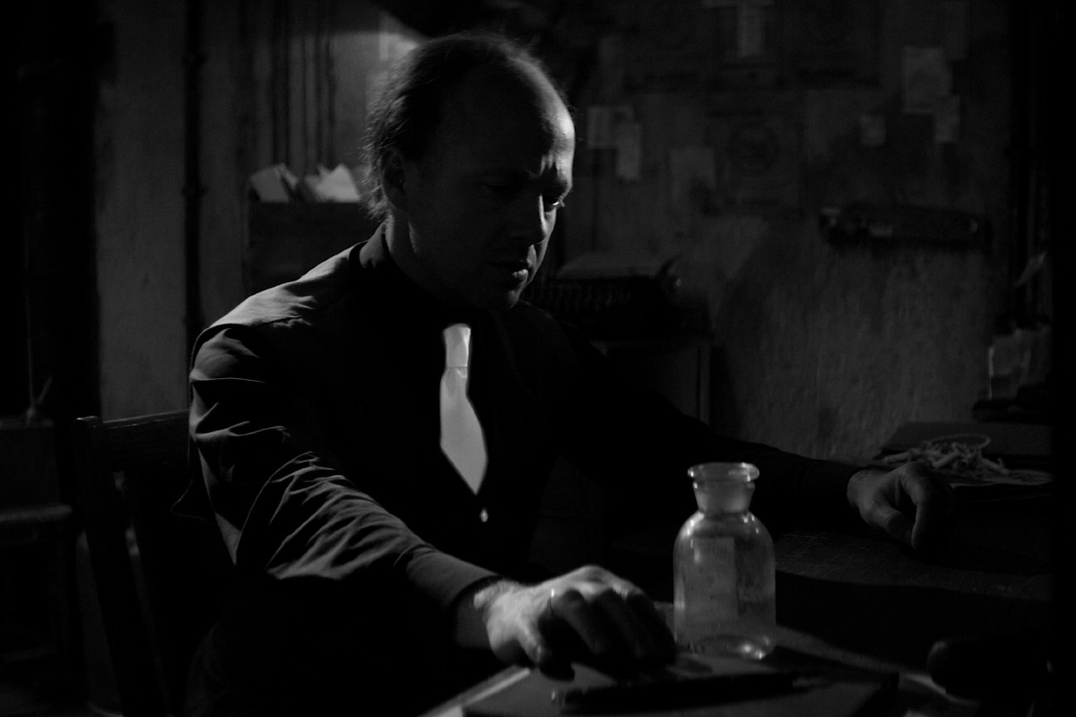 Beholder (short film) - man reaching for glass