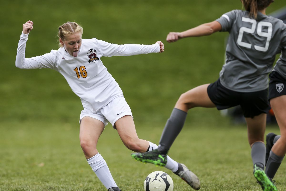 Mountain View's Mackenzie Breiter (16) take a s shot at the goal while defended by Murray's Kyah Karr (29) during the first half of a 5A quarterfinal girls soccer match at Murray Park in Murray on Thursday, Oct. 17, 2019. Mountain View won the match 3-2.
