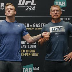 Jim Crute grabs Sam Alvey at UFC 234 media day.