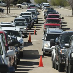 Hundreds of cars wait in lineat the Division of Motor Vehicles drive-thru window in Draper on Friday, April 3, 2020.Some waited in line for hours.
