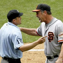 San Francisco Giants manager Bruce Bochy, right, argues with home plate umpire Mike DiMuro after being tossed from the game during the seventh inning in an MLB baseball game against the Arizona Diamondbacks Sunday, April 8, 2012, in Phoenix.