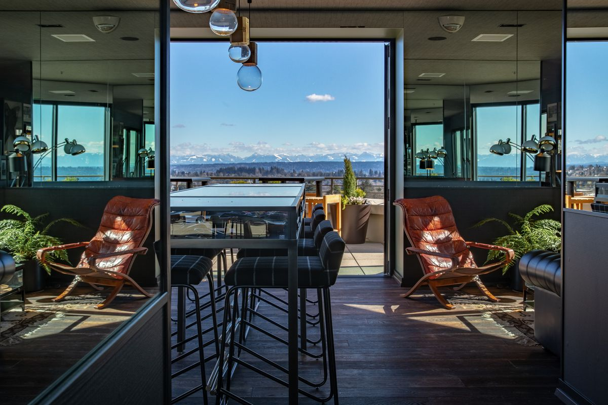 A view of the outdoor seating at Mountaineering Club from inside the restaurant.
