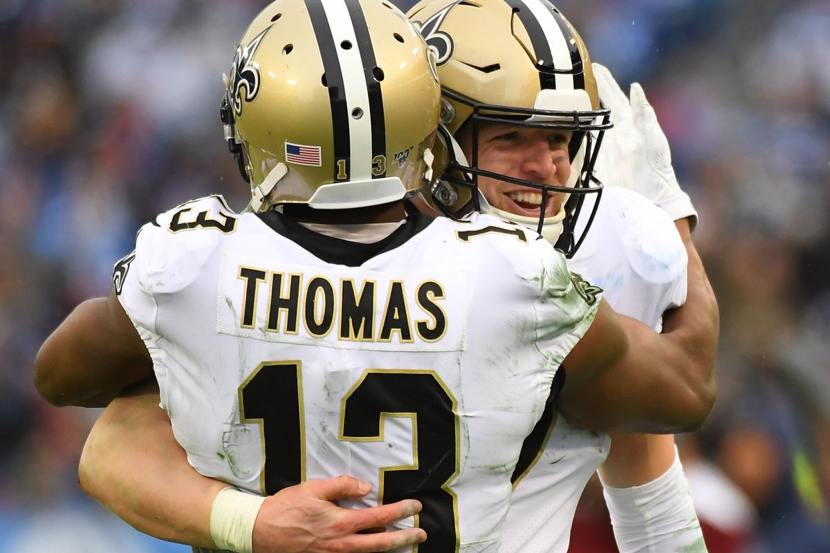 New Orleans Saints quarterback Taysom Hill and New Orleans Saints wide receiver Michael Thomas celebrate after a reception during the second half against the Tennessee Titans at Nissan Stadium.