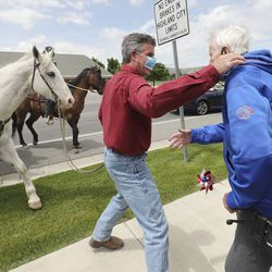 Joe Shelby stops to greet his father, Dale Shelby, as theHighland City Youth Council, city officials,police officers and firefighters participate in a drive-by parade for the residents ofHighland Glen Assisted Living in Highland on Wednesday, May 13, 2020 to show love and support for them.