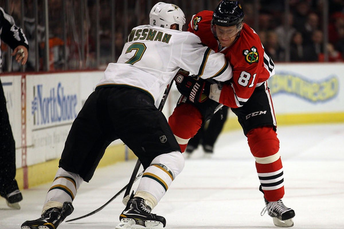 CHICAGO IL - JANUARY 05: Nicklas Grossman #2 of the Dallas Stars hits Marian Hossa #81 of the Chicago Blackhawks in the chest at the United Center on January 5 2011 in Chicago Illinois. (Photo by Jonathan Daniel/Getty Images)