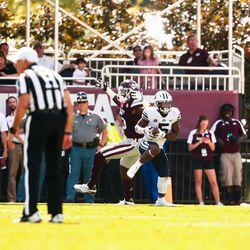 BYU cornerback Dayan Ghanwoloku intercepts a pass against Mississippi State at Davis Wade Stadium in Starkville, Miss., on Saturday, Oct. 14, 2017.