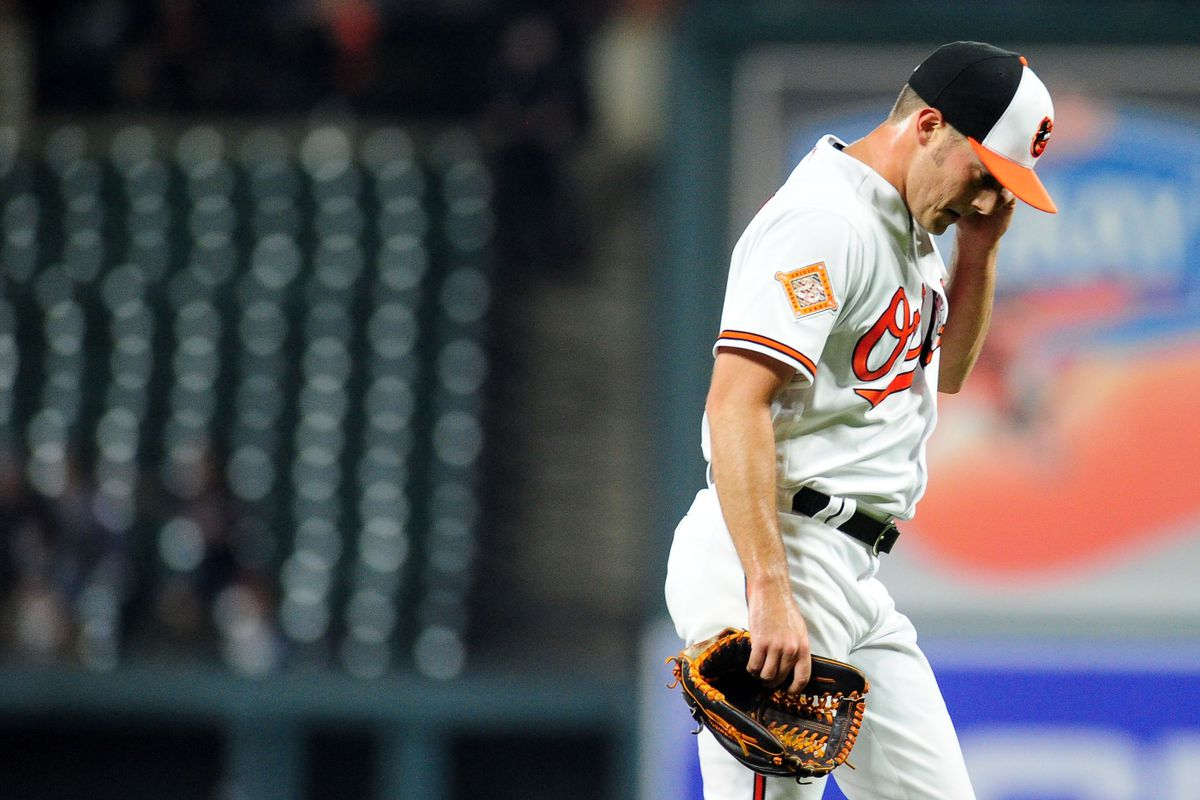 Baltimore Orioles pitcher Tyler Wilson reacts after being removed from the game in the sixth inning against the Minnesota Twins at Oriole Park at Camden Yards.