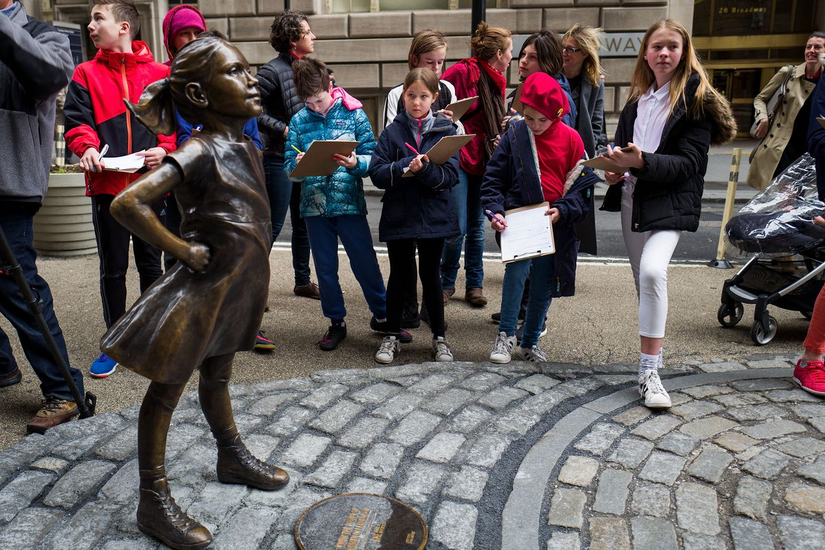 Statue Of Defiant Girl Installed In Front Of Iconic Wall Street Bull By Global Investment Firm