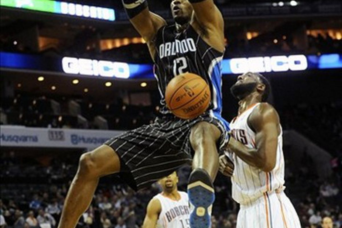 March 6, 2012; Charlotte, NC, USA; Orlando Magic center Dwight Howard (12) dunks during the game against the Charlotte Bobcats at Time Warner Cable Arena. Mandatory Credit: Sam Sharpe-US PRESSWIRE