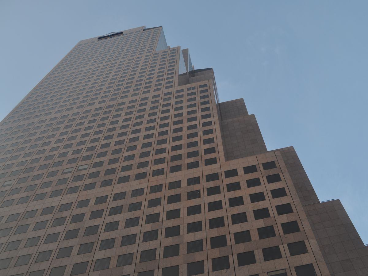 Looking up at a tall skyscraper.