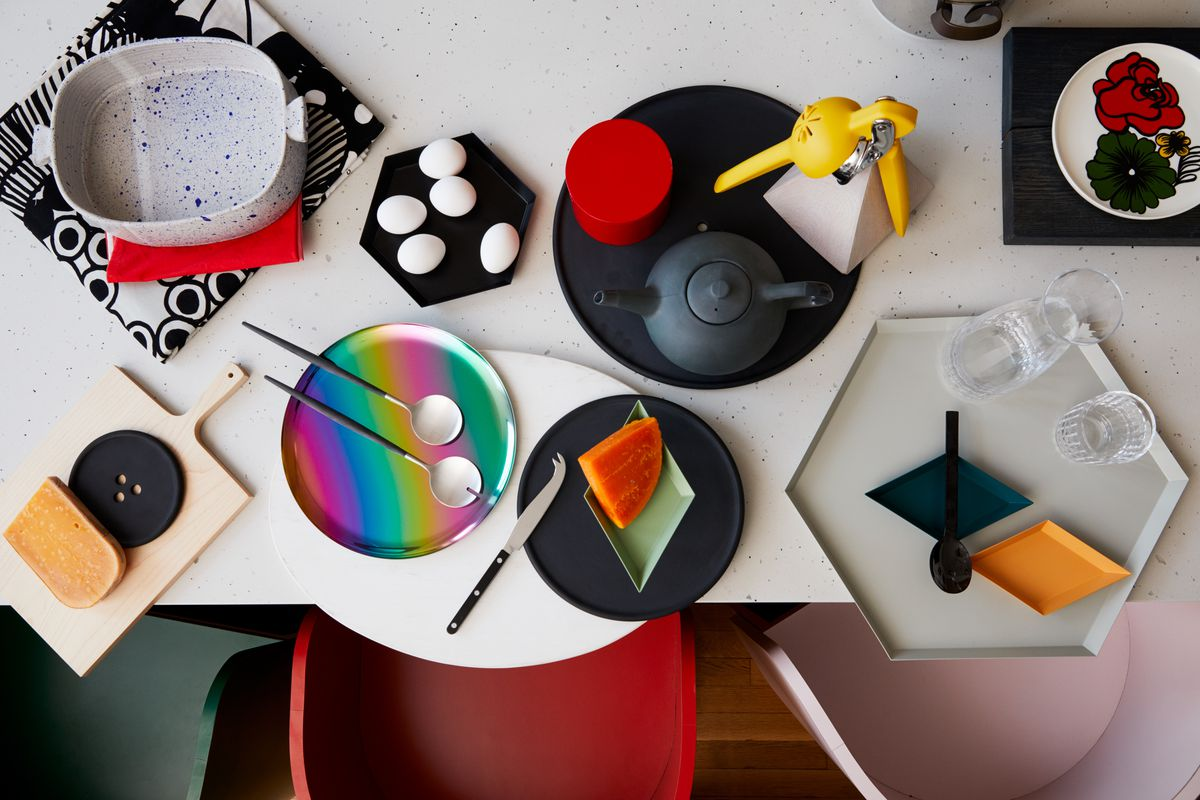 A grouping of various kitchen accessories arranged on a table.