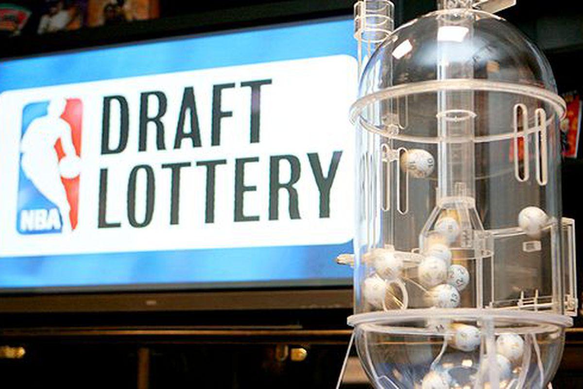 """via <a href=""""http://blogs.suntimes.com/sportsprose/nba-draft-lottery.jpg"""">blogs.suntimes.com</a>"""